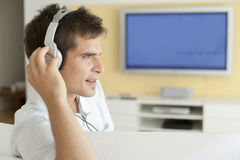 With Headphones and TV Royalty Free Stock Photos