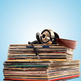 Headphones and vinyl records. Stock Images