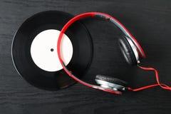 Headphones and vinyl Royalty Free Stock Photography
