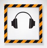 Headphones warning Stock Images
