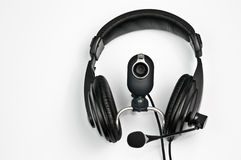 Headphones and webcam. Headphones with a microphone and webcam Royalty Free Stock Image