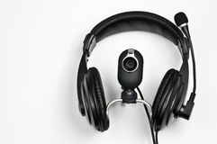 Headphones and webcam. Headphones with a microphone and webcam Stock Image
