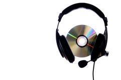 Headphones on a white background. Headphones and CD on a white background Stock Image