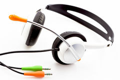 Headphones with white shells ears and a microphone. Stereo headphones with white shells ears and a microphone Stock Photography