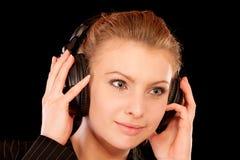 Headphones woman Stock Image