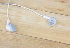 Headphones on wood background Royalty Free Stock Image