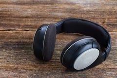 Headphones on wood Stock Image