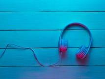 Headphones on wooden background. stock photo