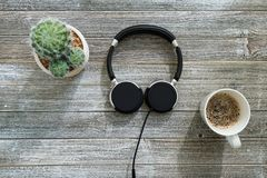 Headphones on a wooden desk royalty free stock photo