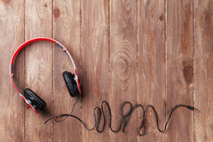 Headphones. On wooden desk table. Music concept. Top view with copy space stock photography