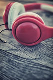 Headphones on a wooden table Stock Photography