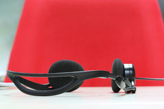 Headphones at workplace Royalty Free Stock Image