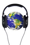 Headphones on the world. A pair of headphones on the world, globe courtesy of NASA public domain images. Isolated on a white background