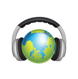 Headphones and world globe isolated Royalty Free Stock Photography