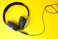 Headphones on yellow Stock Image