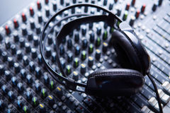 Headpnones on soundmixer. Professional headphones on sound mixer Stock Image