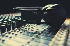 Headpnones on soundmixer Royalty Free Stock Photography