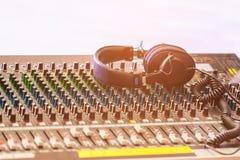 Headpnones on soundmixer. Selective focus Stock Photography
