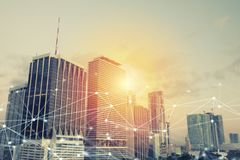 Headquarter of business company during sunrise with network connection effect. Headquarter of growing business company during sunrise with network connection Royalty Free Stock Image