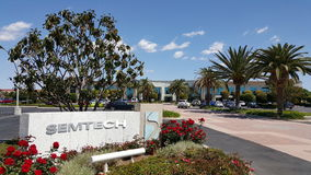 Headquarter office of Semtech, Camarillo, CA. Camarillo, US – April 8, 2015: Hi-Tech company of Semtech front sign and logo with red roses in foreground and Royalty Free Stock Image