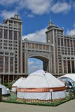 Headquarters of the oil company KazMunaiGaz in Astana. / Kazakhstan - with a taditional Kazakh tent called YURT in the foreground Stock Photos