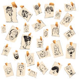 Heads. Hand-drawn collection of heads on various scraps of paper Royalty Free Stock Photos
