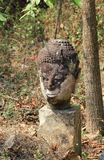 The heads of abandoned old buddha statue Stock Photos