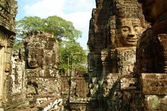 Faces in Angkor Wat. Big god heads at Angkor Wat Royalty Free Stock Image