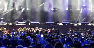 Heads of the audience of the live concert while recording and ph. Many heads of the audience of the live concert while recording and photographing the musicians royalty free stock photos