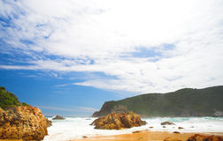 The Heads. Beach covered in driftwood at the bay opening of The Heads in Knysna, Eastern Cape, South Africa stock photos