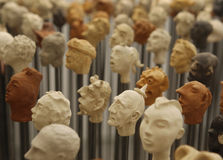 Heads 12. Different ojects representing heads made on clay by various local artists are shown during a local art exhibit call nit de l´art in the Spanish stock image