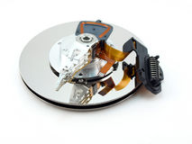 Heads and disk of hard drive Stock Photos