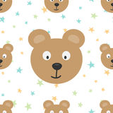 The heads of a funny bear and colored stars. Cartoon seamless pattern. Stock Photography