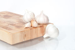 Heads of garlic on a white Royalty Free Stock Photography