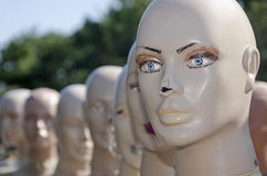Heads of the mannequins standing behind each other Stock Photography
