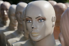 Heads of the mannequins standing behind each other Royalty Free Stock Photos