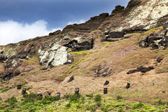 Heads of maoi on Rano Raruku mountain Stock Photo