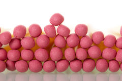 Heads pink matches isolated on white Stock Photography