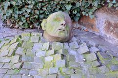Heads of stone. Velbert, NRW, Deutschland - 11.März 2014: In Langenberg Velbert On Old Market in a side street to find this original head. Art on the street Royalty Free Stock Photography