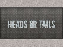 HEADS OR TAILS painted on metal panel wall. HEADS OR TAILS painted on metal panel wall illustration Royalty Free Stock Photography