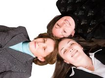 Heads together - business female team Stock Photos