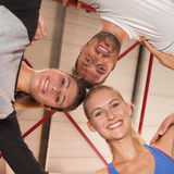 Heads together - fitness team in a gym Royalty Free Stock Images