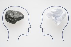 Heads of two people with sawdust brain shape and stone brain shape. Two people with different thinking. Rational and irrational. Heads of two people with stock photos