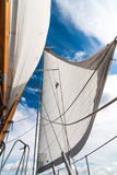 Headsail against blue sky. Small headsail against blue sky Royalty Free Stock Photography