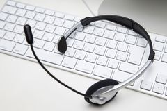 Headset. BUSINESS IMAGE-a headset on a white keyboard Stock Photo