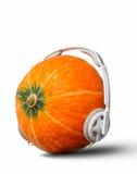 Headset. A pumpkin wearing a headphones Royalty Free Stock Image