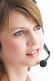 Headset. Woman talking with a headset Stock Images