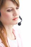 Headset. Woman talking with a headset Royalty Free Stock Image