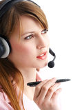 Headset. Woman talking with a headset Royalty Free Stock Photos