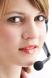 Headset. Woman talking with a headset Stock Image